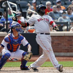New York Mets catcher Anthony Recker, center, watches as Boston Red Sox's David Ortiz, right, hits a sixth-inning two-run home run in an interleague game in New York on Sunday. The Associated Press