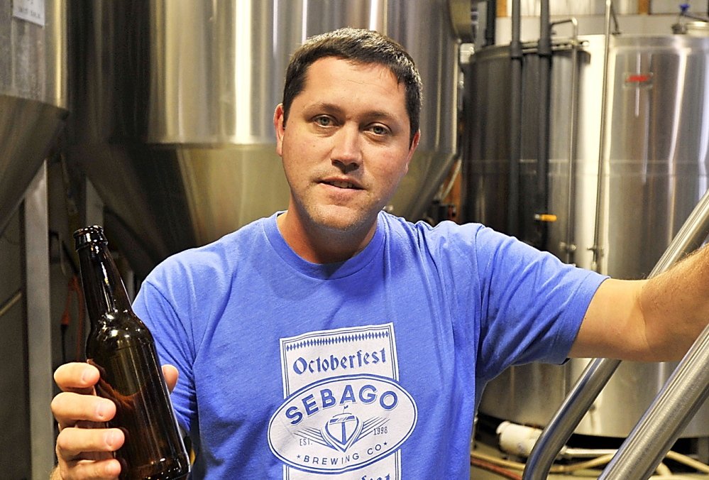 Kai Adams, one of Sebago Brewing Co.'s three co-founders, plans to build a larger brewery. 2013 Press Herald File Photo/Gordon Chibroski