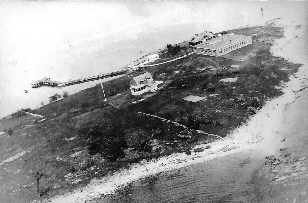 "An undated photo of House Island in the 1920s shows the ""quarantine hospital,"" doctor's house and other structures. From an old postcard provided by Kim MacIsaac"