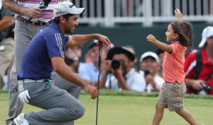 Jason Day gets the best possible congratulations Sunday for winning The Barclays as his son, Dash, races in to give him a hug. Day pulled away to a six-shot victory.