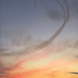 Planes perform a loop at sunset during the Great State of Maine Air Show at the former Brunswick Naval Air Station in Brunswick during its show three years ago.