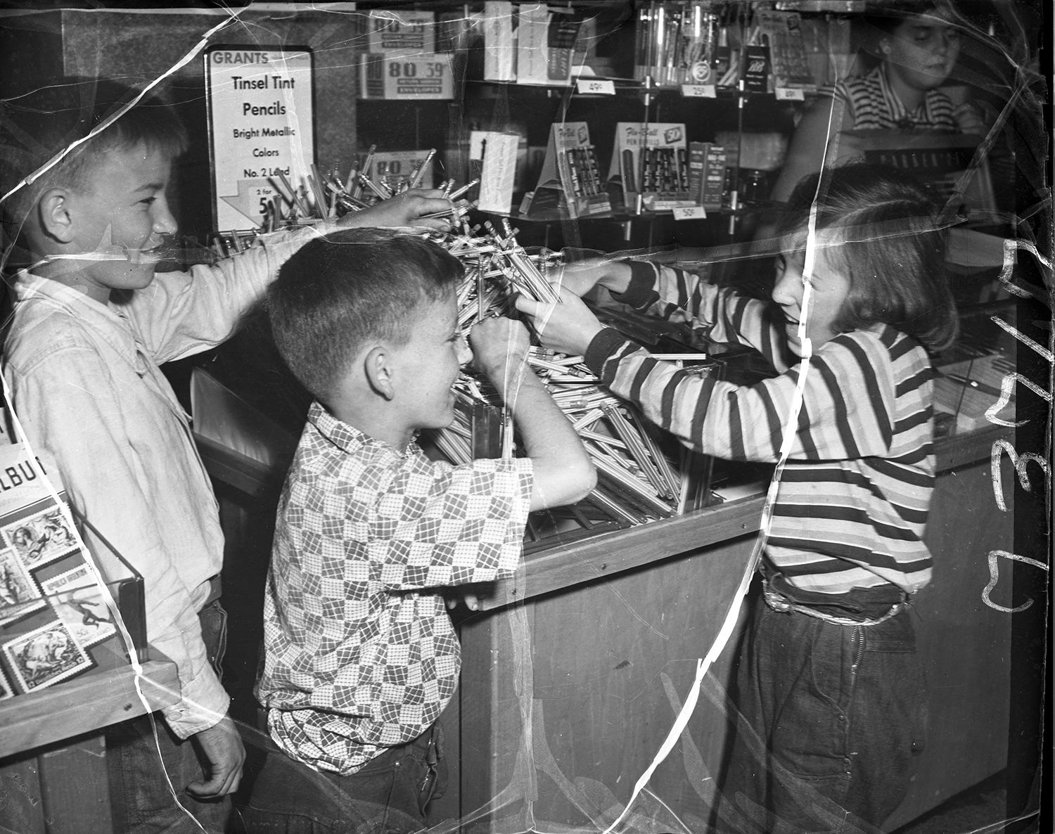 Children buying pencils at W.T. Grant Company Department store, 1953. From the Portland Public Library archival collection of Portland Press Herald, Maine Sunday Telegram and Evening Express photos.