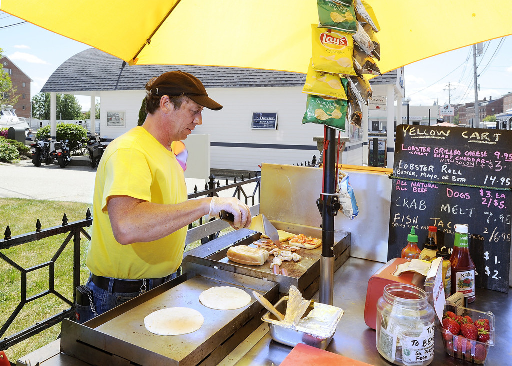 Joel Glatz owns the Yellow Cart and specializes in a grilled lobster and cheese with optional bacon, as well as fish tacos, hot dogs and crab melts. Gordon Chibroski/Staff Photographer