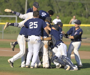 Coffee News players celebrate their 12-9 win over South Portland's Morrill Post in the American Legion baseball state championship game Sunday. It's the second straight state title for the Bangor-based team. John Ewing/Staff Photographer