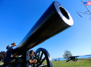 """Wyatt Kennedy, 8, right, and his brother Kahlil, 10, of Portland take their positions on a canon at Fort Allen park during an outing with their grandmother. The brothers thought it would be fun to dress up as a ranger (with a """"nerf"""" gun) and a cowboy and have their grandmother take pictures of them at the park."""