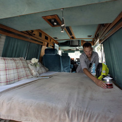 Jonathan Powley, who rents parked vehicles on Airbnb, prepares a 1995 Chevrolet conversion van, one of his offerings, in the Queens borough of  New York.