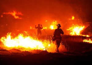 A firefighter lights a backfire as the Rocky Fire burns near Clearlake, Calif., on Monday, Aug. 3, 2015. The fire has charred more than 60,000 acres and destroyed at least 24 residences. (AP Photo/Josh Edelson)