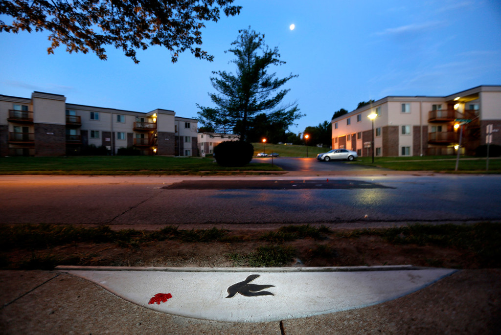 Aug. 2 2015 A marker in the shape of a dove is embedded in the sidewalk near the spot where Michael Brown was shot and killed by police officer Darren ... & A year after Michael Brownu0027s death Ferguson has changed - Portland ...