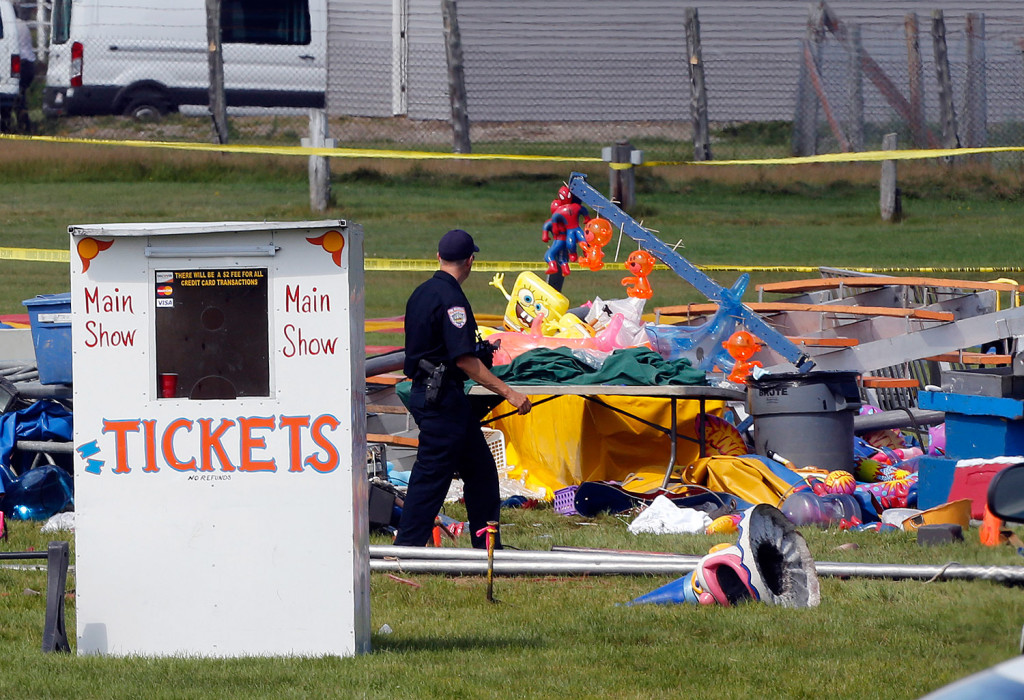 Investigators on Tuesday inspect the site of a circus tent that collapsed Monday during a show by the Walker Brothers International Circus at the Lancaster Fairgrounds in Lancaster, N.H.