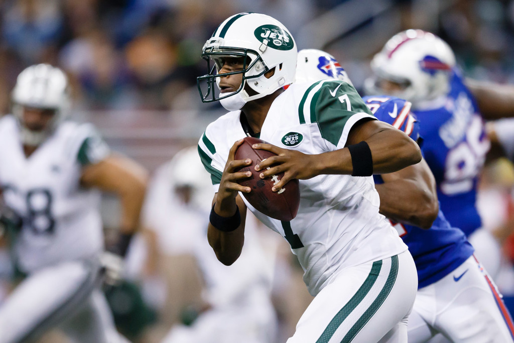 New York Jets quarterback Geno Smith runs the ball against the Buffalo Bills during a game last year. He has been sidelined with a jaw injury after being punched by a teammate.