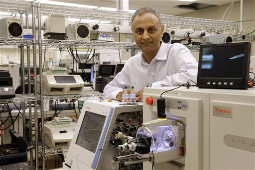 Dr. Akhilesh Pandey, a researcher at Johns Hopkins University, stands alongside a mass spectrometer in his laboratory. Pandey's research analyzes both adult and fetal tissue, and by identifying which proteins are present, he can get clues that could be used to help detect cancer in adults earlier. The Associated Press