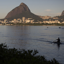 A man rows in the Rodrigo de Freitas Lake, in Rio de Janeiro. Thewater was thought to be safe for rowers and canoers but tests have shown it to be among the most polluted for Olympic sites.