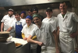 Chef-owners Karl Deuben, far right, and Bill Leavy, in blue apron, with their crew in the East Ender kitchen. Press Herald file photo