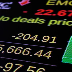 A screen above the trading floor of the New York Stock Exchange shows the closing number for the Dow Jones industrial average, Tuesday. U.S. stocks closed lower Tuesday after falling sharply in the final hour of trading. The Associated Press