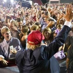 Republican presidential candidate Donald Trump waves to the crowd during a campaign pep rally in Mobile, Ala., on Friday. The Associated Press