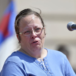 Rowan County (Ky.) Clerk Kim Davis shows emotion as she is cheered by a gathering of supporters during a rally on the steps of the Kentucky State Capitol in Frankfort last week.