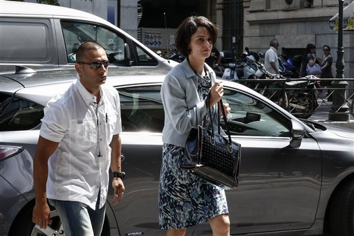 Delia Velculescu, the International Monetary Fund mission chief for Greece, right, arrives at the Labor Ministry in Athens on Monday.  The Associated Press
