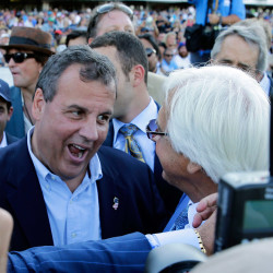 "New Jersey Gov. Chris Christie, left, congratulates Triple Crown winner American Pharoah's trainer Bob Baffert after American Pharoah won the Haskell Invitational horse race at Monmouth Park in Oceanport, N.J., on Sunday. Christie on Sunday called a national teachers union ""the single most destructive force in public education."""