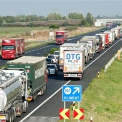 Vehicles  wait  on the M1 motorway near the border between Hungary and Austria Monday. Every vehicle capable of smuggling people is checked  at the border after 71 migrants were found dead in a truck Thursday.  The Associated Press