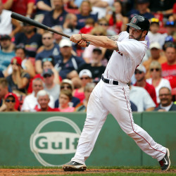 Boston Red Sox's Blake Swihart follows through on his fourth hit of the game, a double in the eighth inning of their 22-10 win over the Seattle Mariners at Fenway Park in Boston on Saturday.