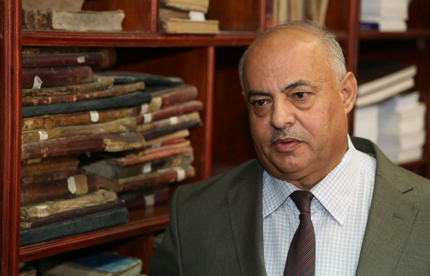 Jamal Abdel-Majeed Abdulkareem, acting director of Baghdad libraries and archives, speaks during an interview with The Associated Press at the Baghdad National Library in Iraq. The Associated Press