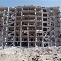 A 1996 photo of the destroyed Khobar Towers and crater where a truck bomb exploded, killing 19 Americans and injuring hundreds in Dhahran, Saudi Arabia. The Associated Press