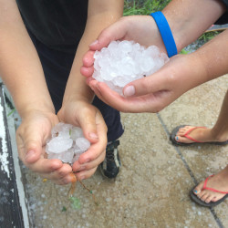 Staff Writer Noel Gallagher took this photo of Kate and Dan Gallagher holding hail that fell on Portland today.