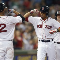 Red Sox center fielder Mookie Betts, center, celebrates his solo home run with teammate Xander Bogaerts in the seventh inning against the Kansas City Royals in Boston on Saturday. The Associated Press