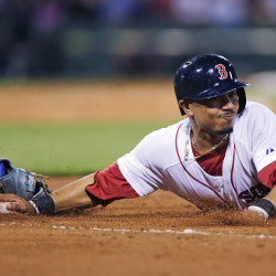 Boston's Mookie Betts dives back safely under the tag of Kansas City first baseman Eric Hosmer on a pick-off attempt in the seventh inning Thursday at Fenway Park. The Associated Press