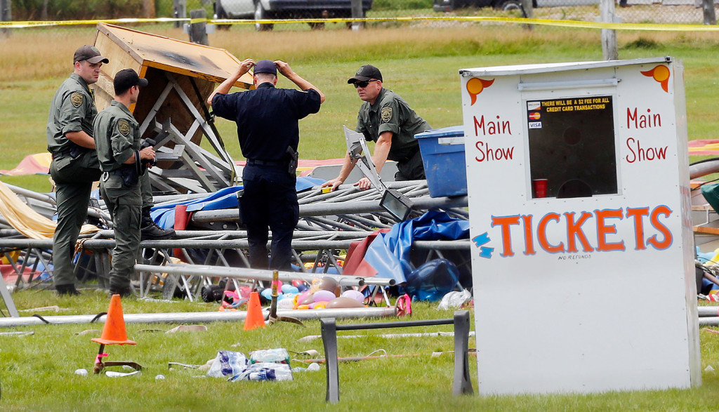 Investigators are at the scene of a circus tent that collapsed, killing a father and his 6-year-old daughter in Lancaster, N.H.  in this Aug. 4 file photo. Since the accident, questions have been asked about how the circus operator could have prepared for, then put on a show in the middle of the town's fairgrounds without getting a permit or having the giant canopy inspected. The Associated Press