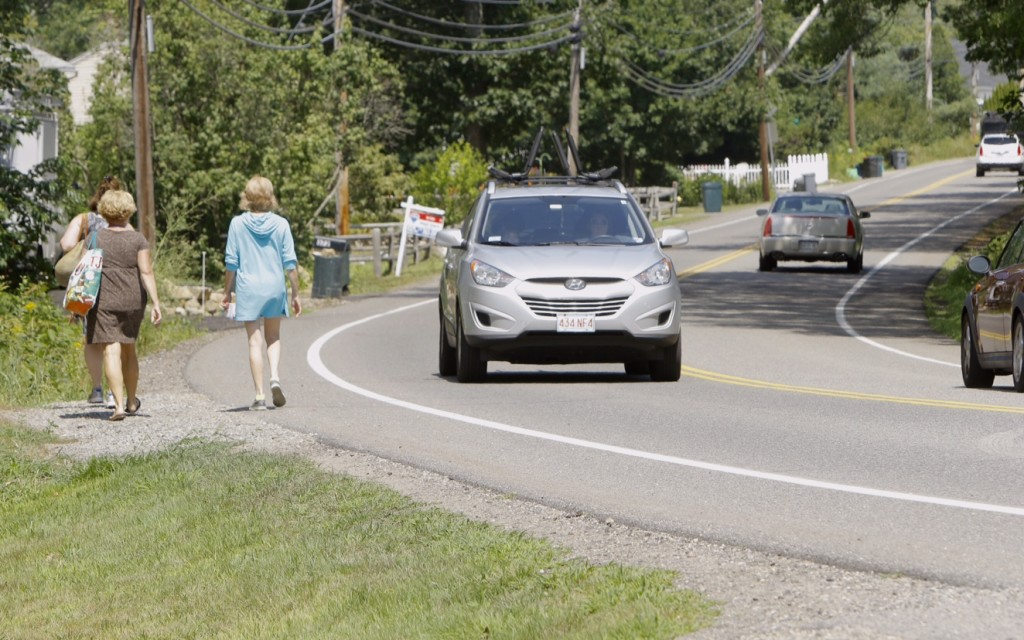 Women walk along Ridge Road in York near the site where police say that Carolyn Lee, 21, of York, struck Emily Zarnoch, 23, of Massachusetts early on Tuesday morning. Zarnoch died a few hours later of her injuries and police say that Lee was driving drunk at the time of the accident. Gregory Rec / Staff Photographer