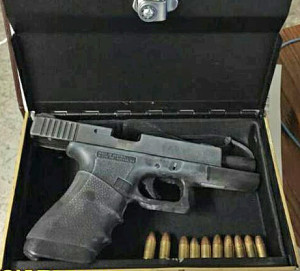 New York City police photo of loaded Glock found in hollowed-out King James Bible.