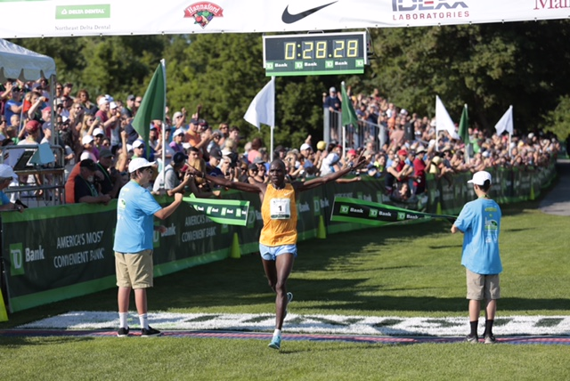 Kenya's Stephen Kosgei-Kibet crosses the finish line Saturday to win the 18th Beach to Beacon 10K in Cape Elizabeth. Gabe Souza/Staff Photographer.