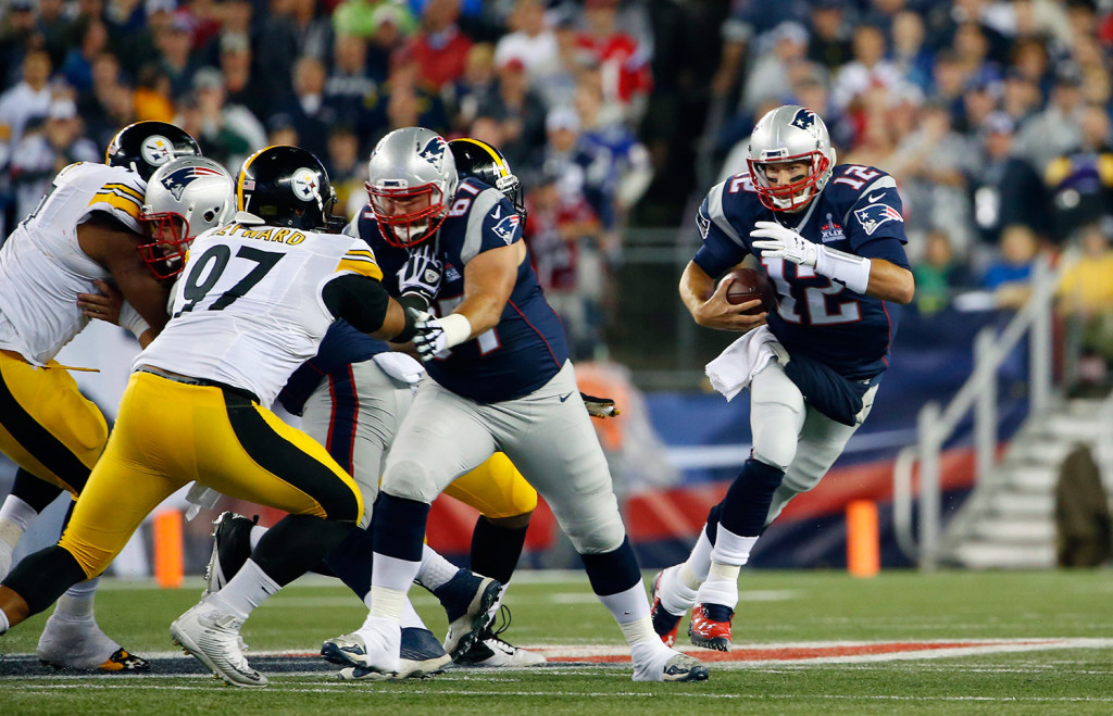 Tom Brady scrambles in the first half against the Steelers' defense. He ended the game with 288 yards and four touchdowns passing. The Associated Press