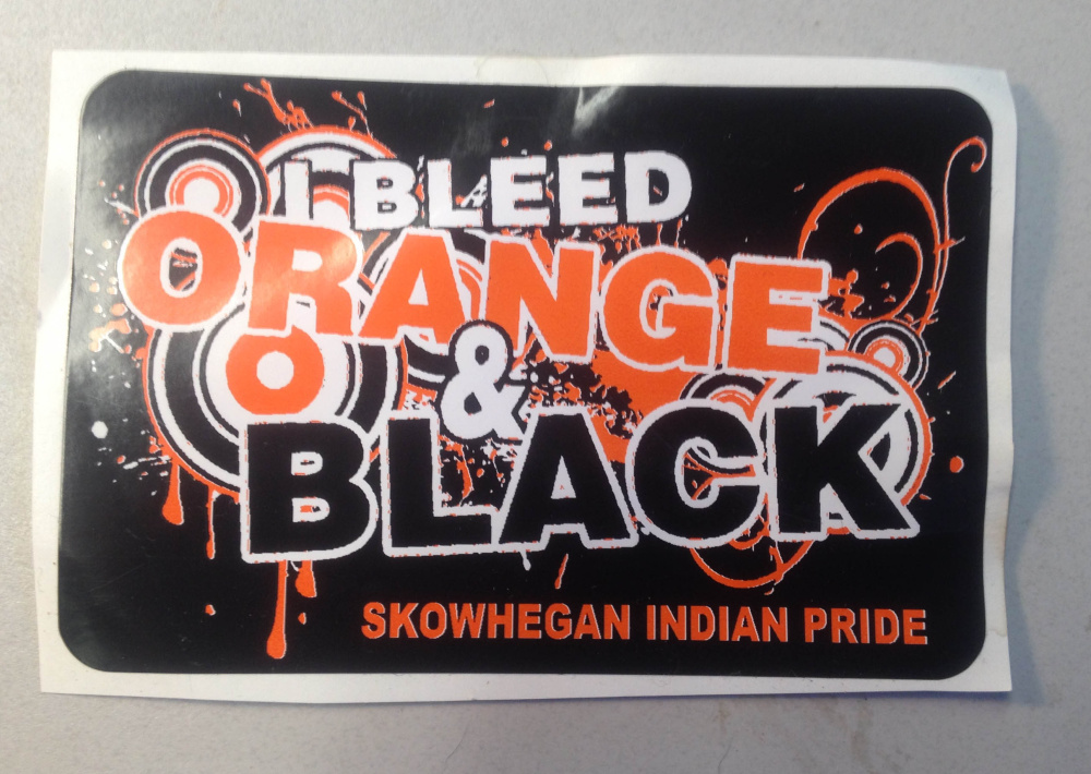 "T-shirts and stickers, like this one, that say ""I bleed orange & black — Skowhegan Indian Pride"" will be given away at the Skowhegan Indian Pride rally on Columbus Day."