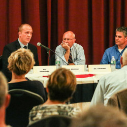 Tom MacMillan, left, Mayor Michael Brennan, center, and Ethan Strimling debate at Mechanic Hall in Portland on Wednesday night. Strimling and MacMillan said Brennan has ignored the concerns of Portland residents. Whitney Hayward/Staff Photographer