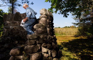 """John Willey descends from """"The Pulpit,"""" a stone structure at the terminus of the Dartmouth Trail at the Good Will Hinkley Museum."""