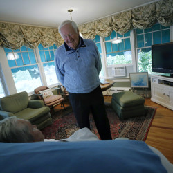 John Marr of Falmouth whose wife Josephine has been battling Alzheimer's for the last seven years recently donated $2 million to Brigham and Women's Hospital in Boston to fund research. John talks to his wife as she rests at their home in Falmouth. Derek Davis/Staff Photographer