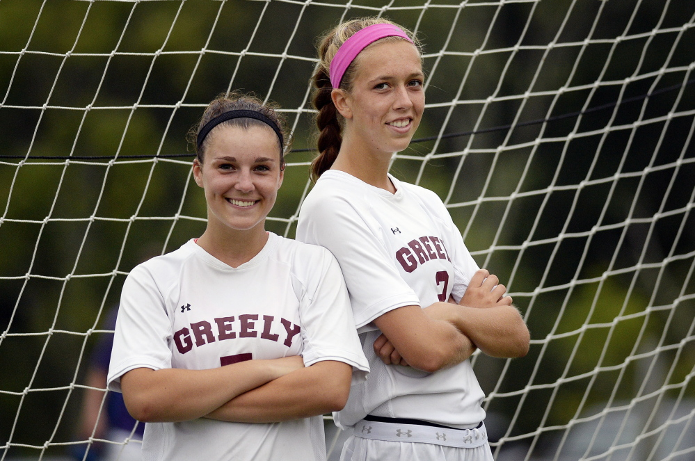 "Izzy Hutnak, left, and Jocelyn Mitiguy have played together so long they have a sense of where the other will be at any given time. ""I'm anticipating Jocelyn's run as soon as the ball's coming to me, before it gets to my feet,"" Hutnak said. The duo combined for 27 goals last season."