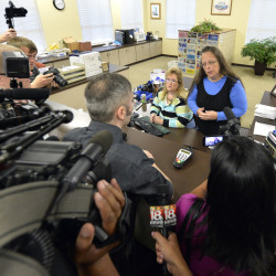 Rowan County Clerk Kim Davis, right, talks with David Moore following her office's refusal to issue marriage licenses at the Rowan County Courthouse in Morehead, Ky., Tuesday.