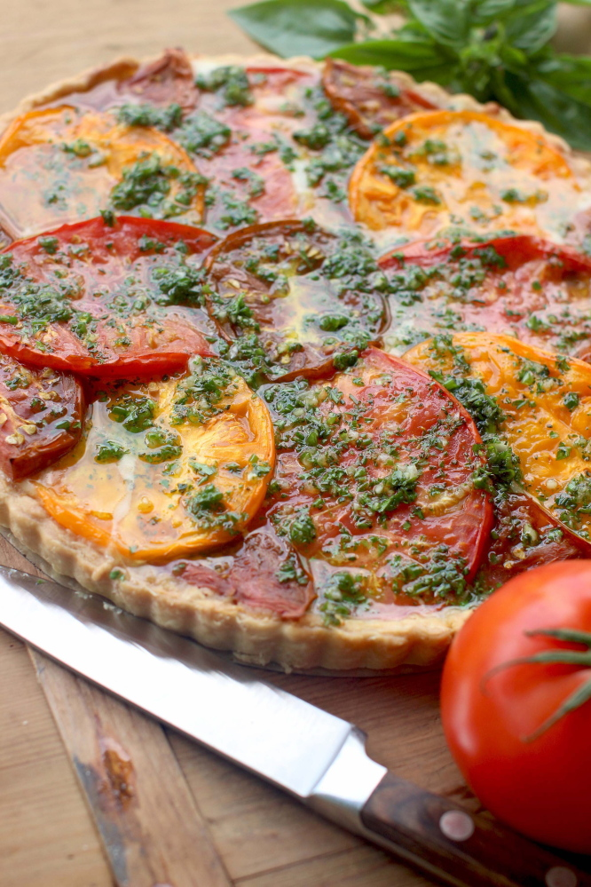 A tomato tart with Gruyere and herbs.