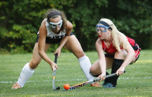 Alexis Tworkowski, left, of Marshwood and Lucy Malia of Scarborough battle for possession during a season-opening field hockey game Wednesday in South Berwick. Scarborough, the reigning Class A state champion, got two second-half goals for a 2-0 victory.