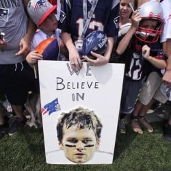 New England Patriots fans show their support for New England quarterback Tom Brady.