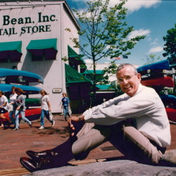 Leon Gorman sits in a relaxed pose outside L.L. Bean retail store in Freeport on August 20, 1992. Photo by Merry Farnum