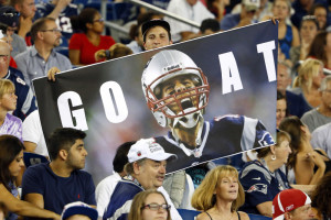 Fans hold a photo of Tom Brady in the stands at Gillette Stadium, celebrating a judge's reversal of Brady's four-game suspension earlier Thursday.