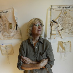 "Jo Israelson with some of her work ""Sarah's Genorosity,"" part of her exhibition ""Welcoming the Stranger."""