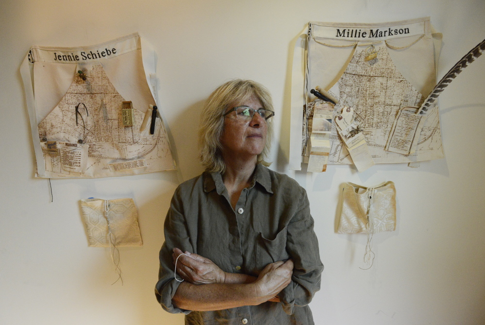 """Jo Israelson with some of her work """"Sarah's Genorosity,"""" part of her exhibition """"Welcoming the Stranger."""""""