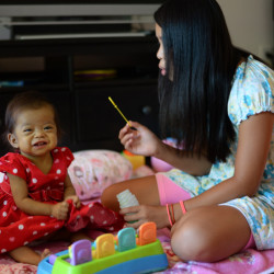 Hope Morrison, 17 months, plays with her sister Lianna, 10, last month at their home in Andover, Mass.  A few months ago, Hope was an underdeveloped, emaciated baby living with end-stage liver failure in a Chinese orphanage.