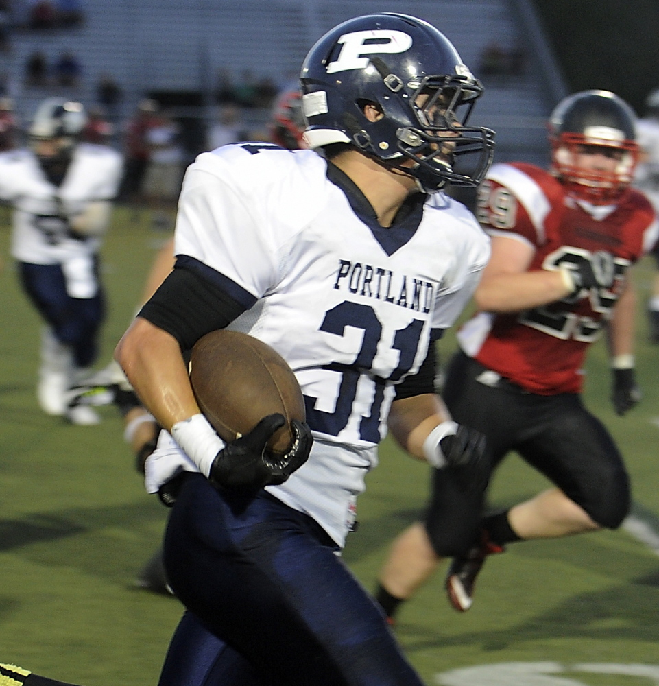 Portland's Joe Esposito finds running room for a 32-yard gain.