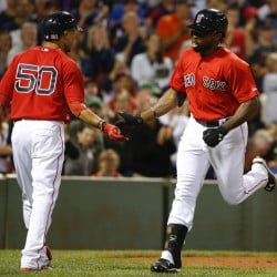Boston's Jackie Bradley Jr. is congratulated by teammate Mookie Betts after hitting a home run in the seventh inning of Friday night's win over the Phillies.